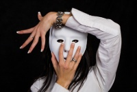 Beautiful woman hiding behind a mask