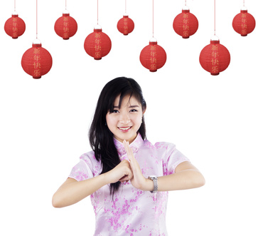 Pretty young woman celebrating chinese new year